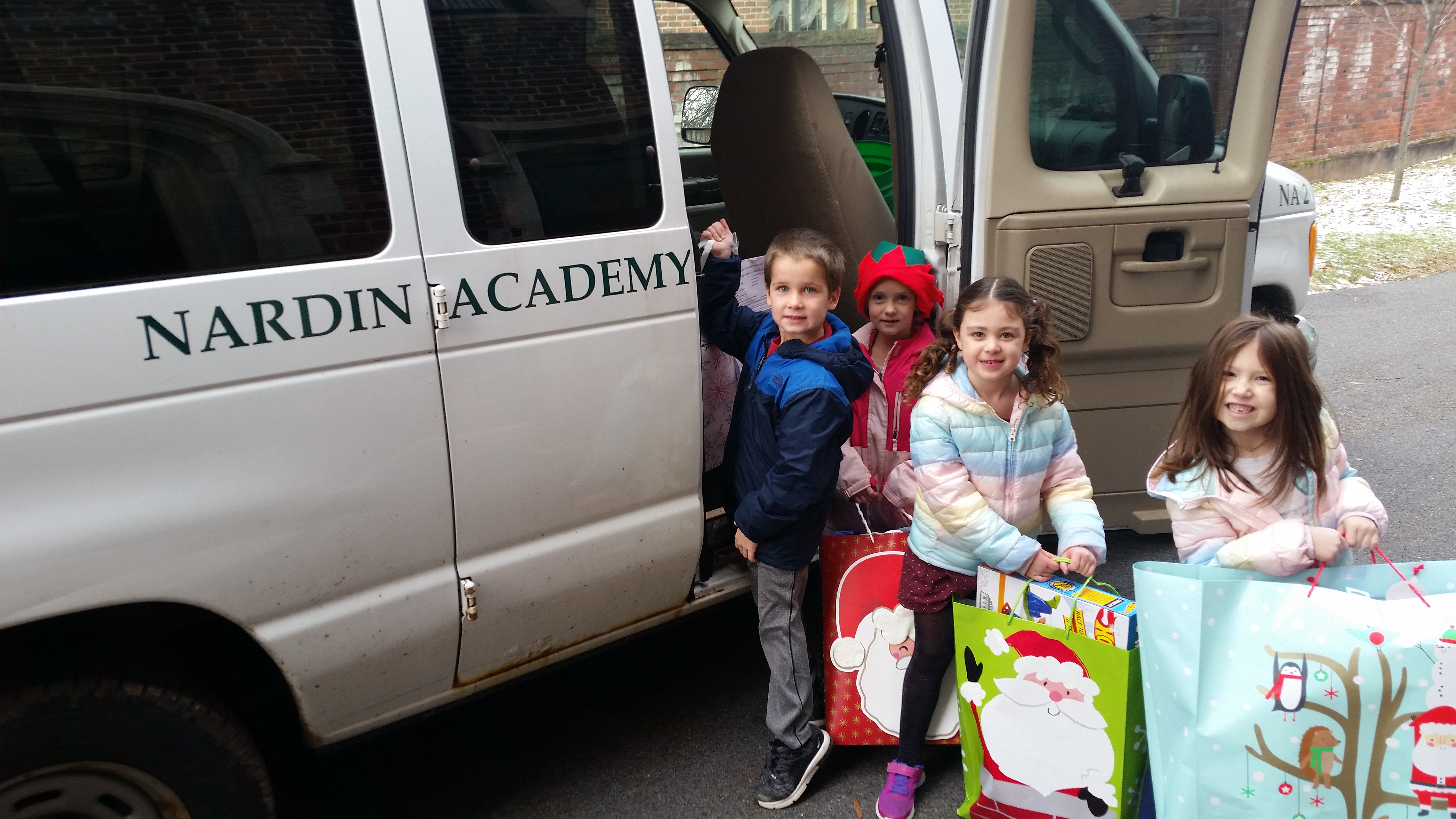 Montessori Students Putting Donations in Van
