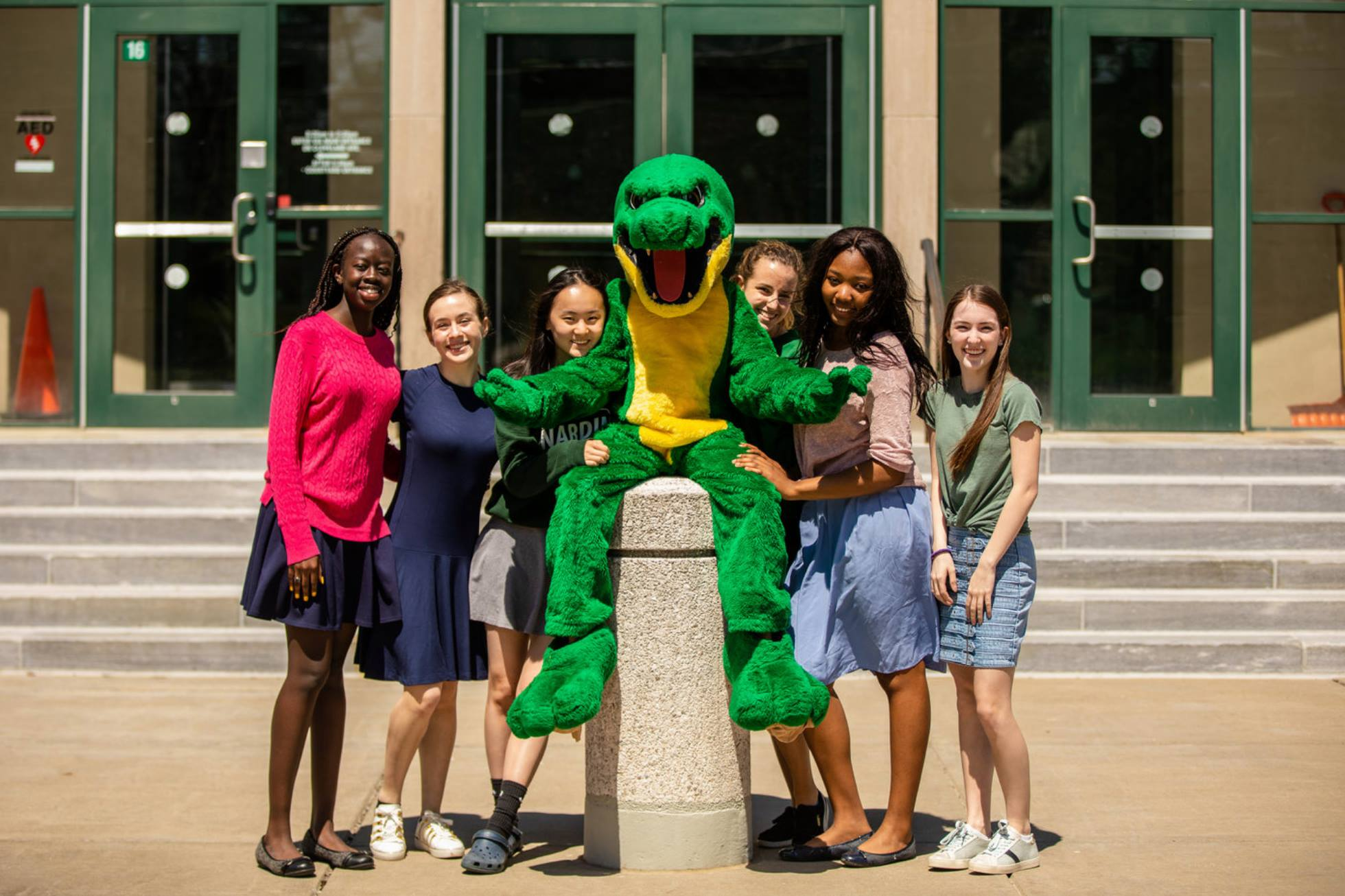 girls with Gator mascot