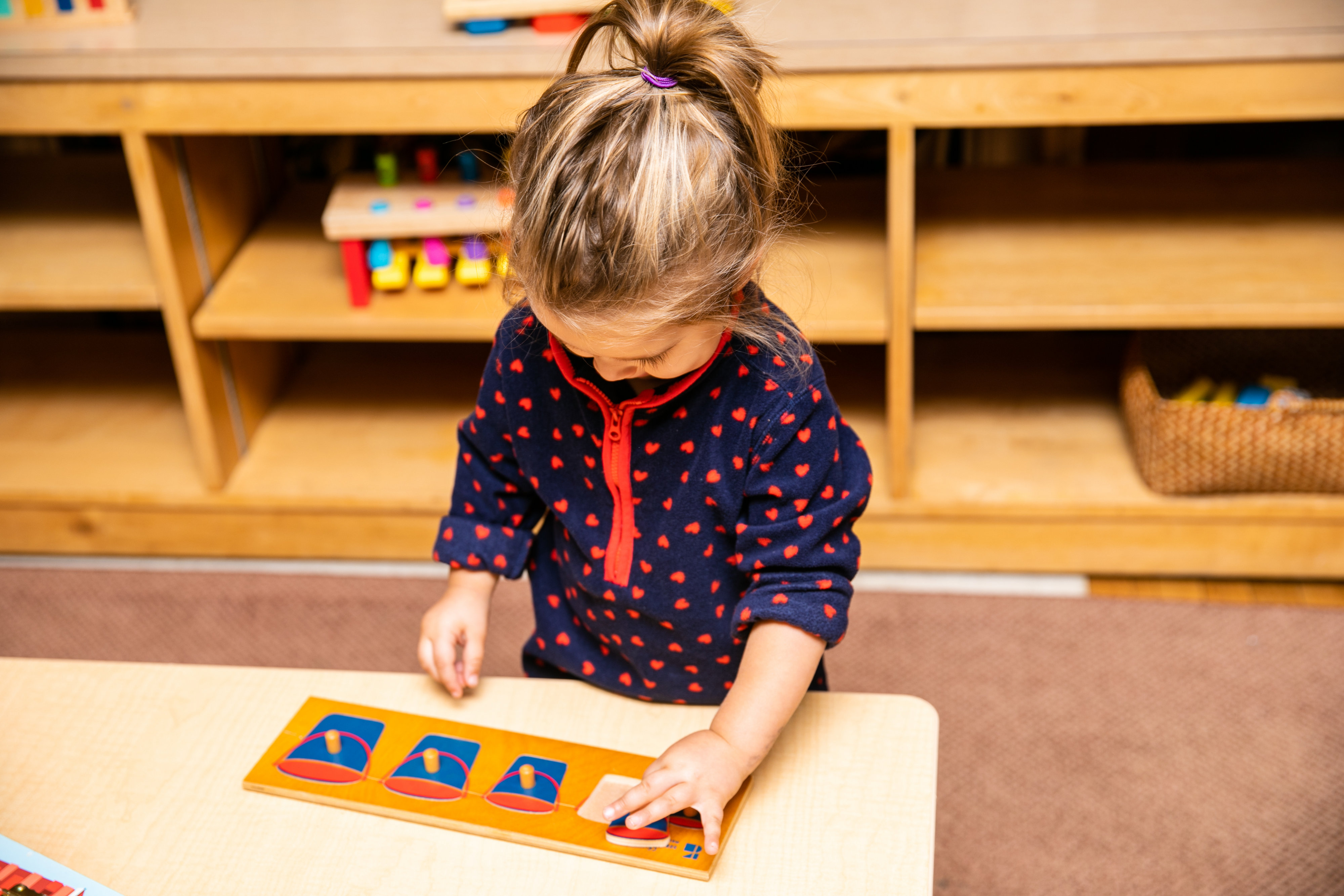 Girl using Montessori materials